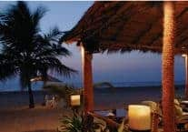 Relax on the beach at Leela Goa